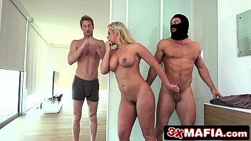 A masked man fucks a blonde standing - porn movies